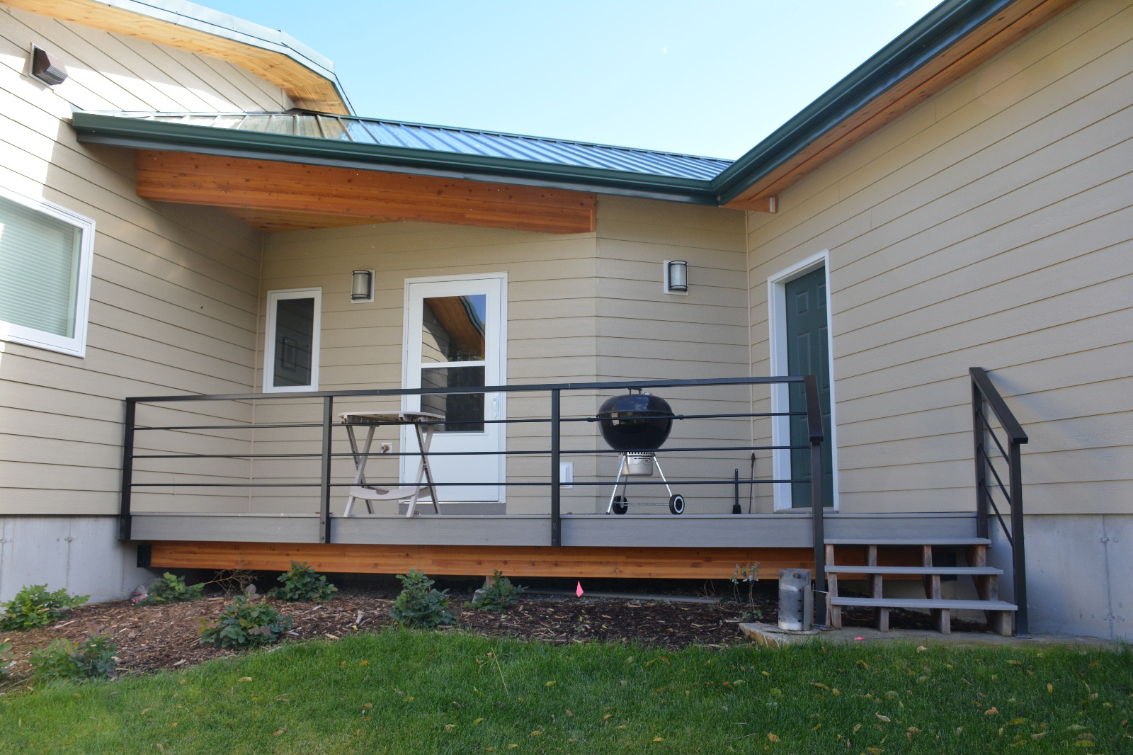Exterior porch with custom steel handrail